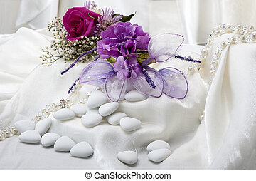Wedding favors - flowers candy and weddings favors on white...