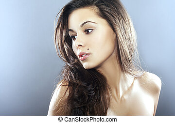 Young Woman on blue backg