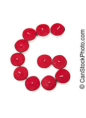Letter G formed by candles on a white background