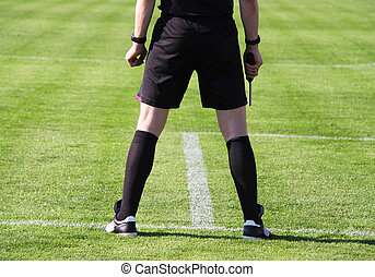 Referee - Soccer or football assistant referee during a game
