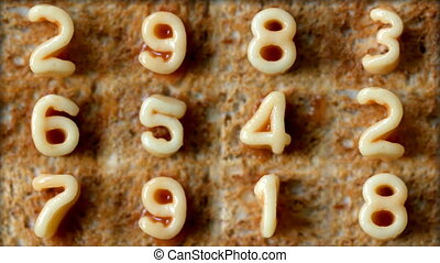 number sequence made from spaghetti pasta letters in tomato...