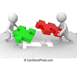 Teamwork - Two people are moving the puzzles