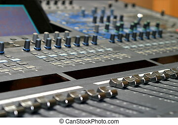 Mixing Console - Top view of a mixing console in a music...