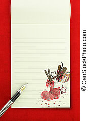Christmas notebook on red background