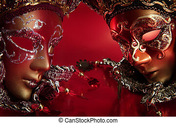ornate carnival masks over textured metallic background