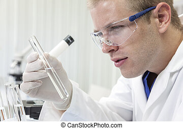 Male Scientist or Doctor With Test Tube In Laboratory
