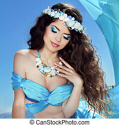 Makeup Sea jewelry Long Healthy Hair Beautiful girl in blue...