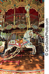 Carousel with horses - View of the inside of a colorful...