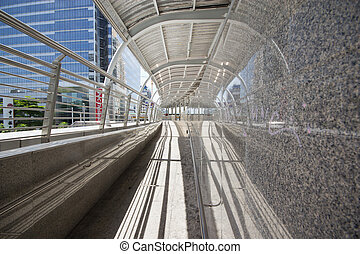 BRT - Pubic skywalk with modern buildings of Bangkok