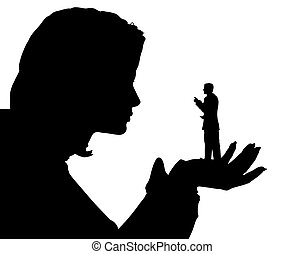 Belittled - Silhouette of a minature man in the palm of a...