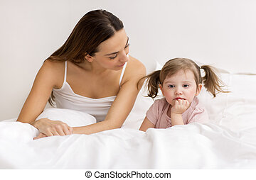 Little girl sulking with her mother - dispute between a...