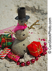 Christmas Vacation on the beach - A snowman made from sand...