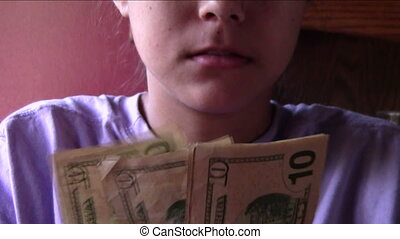 Counting Money - young woman counting paper money