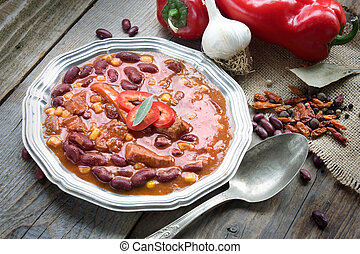 Chili con carne plate Mexican traditional dish in rustic...