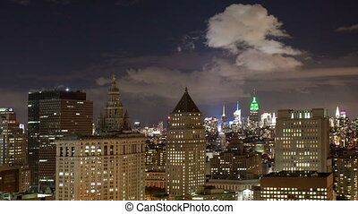 timelapse view of manhattan skyline from a high vantage point at night