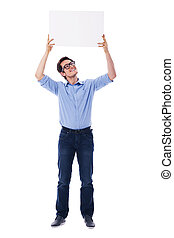 Handsome man holding a blank sign overhead