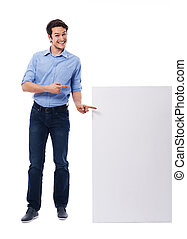 Happy man pointing on the white board