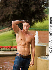 Healthy male model - A male model outside beside a water...