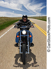 Country travel - A biker taking a ride on a country highway