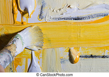 Artist at work - An artist at work on a canvas with his...