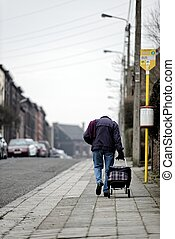 Old man on his way home in the ghetto