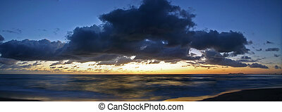 Beach Sunrise Panorma - The sunrise over a beautiful...