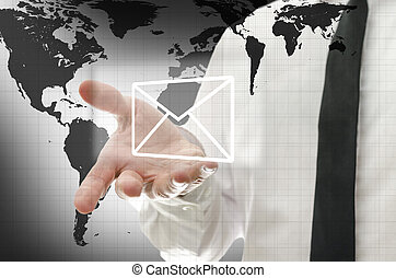 Global communications - Businessman presenting mail icon on...