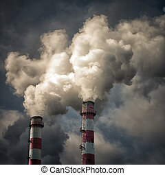 Industry pollution - Two pipes smoke againts the cloudy sky
