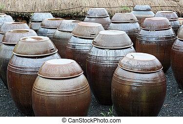 traditional korean kimchi pots - heavy pots containing...