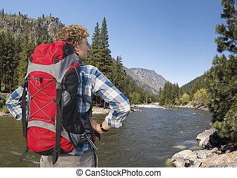 North Cascades Hiker - Hiker, with backpack, standing on the...