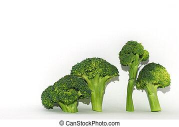 four brokoli right on white - four fresh green brokoli right...