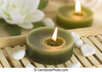 Spa and wellness setting with natural soap, candles and...