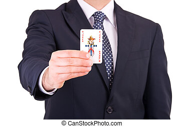 Businessman showing playing card.