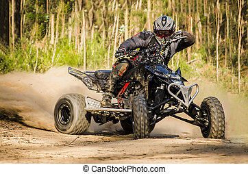 ATV racer takes a turn during a race - ATV racer takes a...