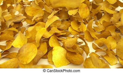 Heap of Potato chips falling down o - Heap of Potato chips...