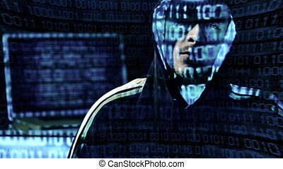 Hacker Portrait - Hacker looking at the camera with laptop,...