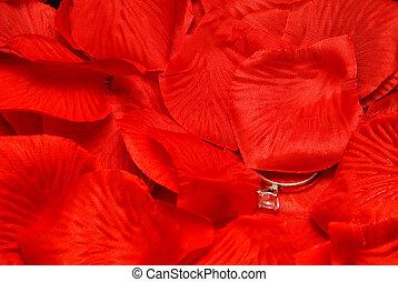 Wedding Ring - A diamond wedding ring on a fake rose petal.
