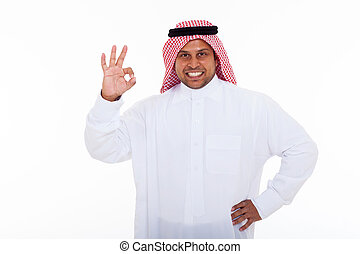 Muslim man giving okay hand sign - happy muslim man giving...