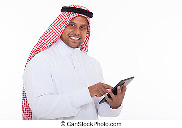 arabian man using tablet computer - happy arabian man using...
