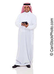 middle eastern man using tablet computer