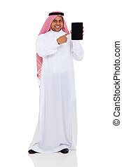 middle eastern man pointing at tablet computer - smiling...