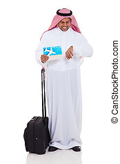 middle eastern businessman checking flight time isolated on...