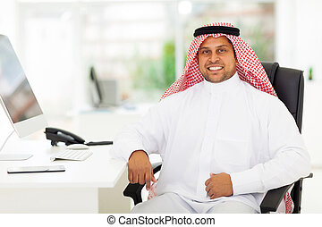arabian business man in office - smiling arabian business...