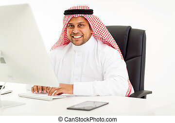 modern arabic businessman using computer in office