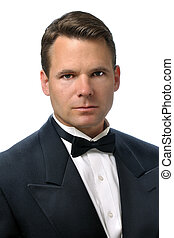 Man in tux - Closeup of handsome Caucasian man with serious...