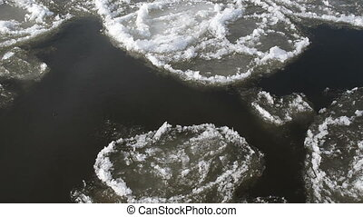 piece ice river water - dark river swims large pieces of...