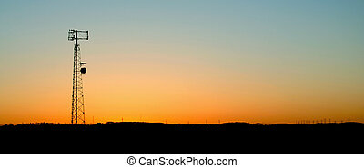 Pale Blue Cell Phone Tower Sunset - A cell phone tower...