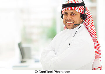 arabian IT support worker with headphone - friendly male...