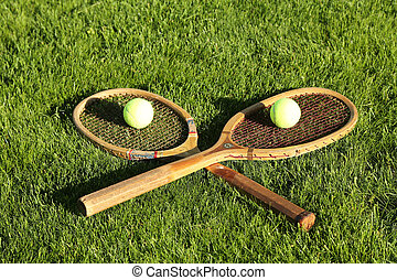 Old tennis rackets on grass court
