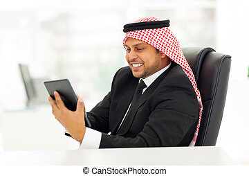 muslim businessman using tablet computer
